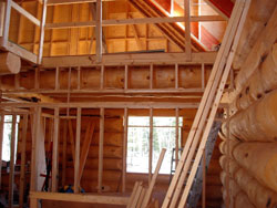 Angels Log Homes (temporary) construction safety guard rail for loft floor