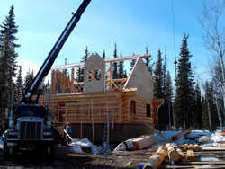 Angels Log Homes dormer gable under construction (with notch out for ridge beam)