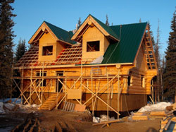 Angels Log Homes installation of metal roof system